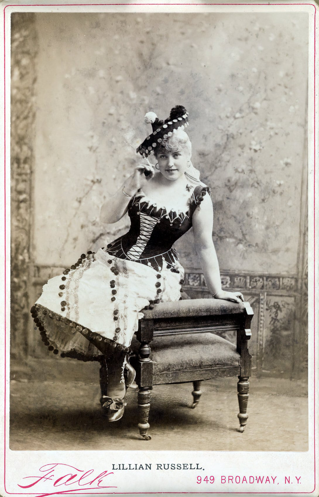 Vintage actress Lillian Russell in a black corset