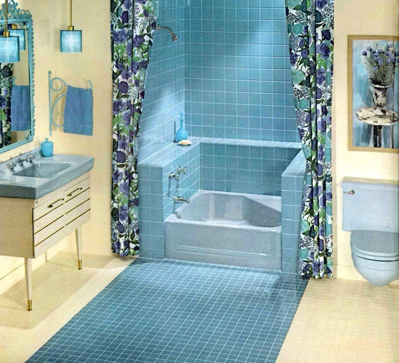 Blue tiled shower enclosure with small square bathtub