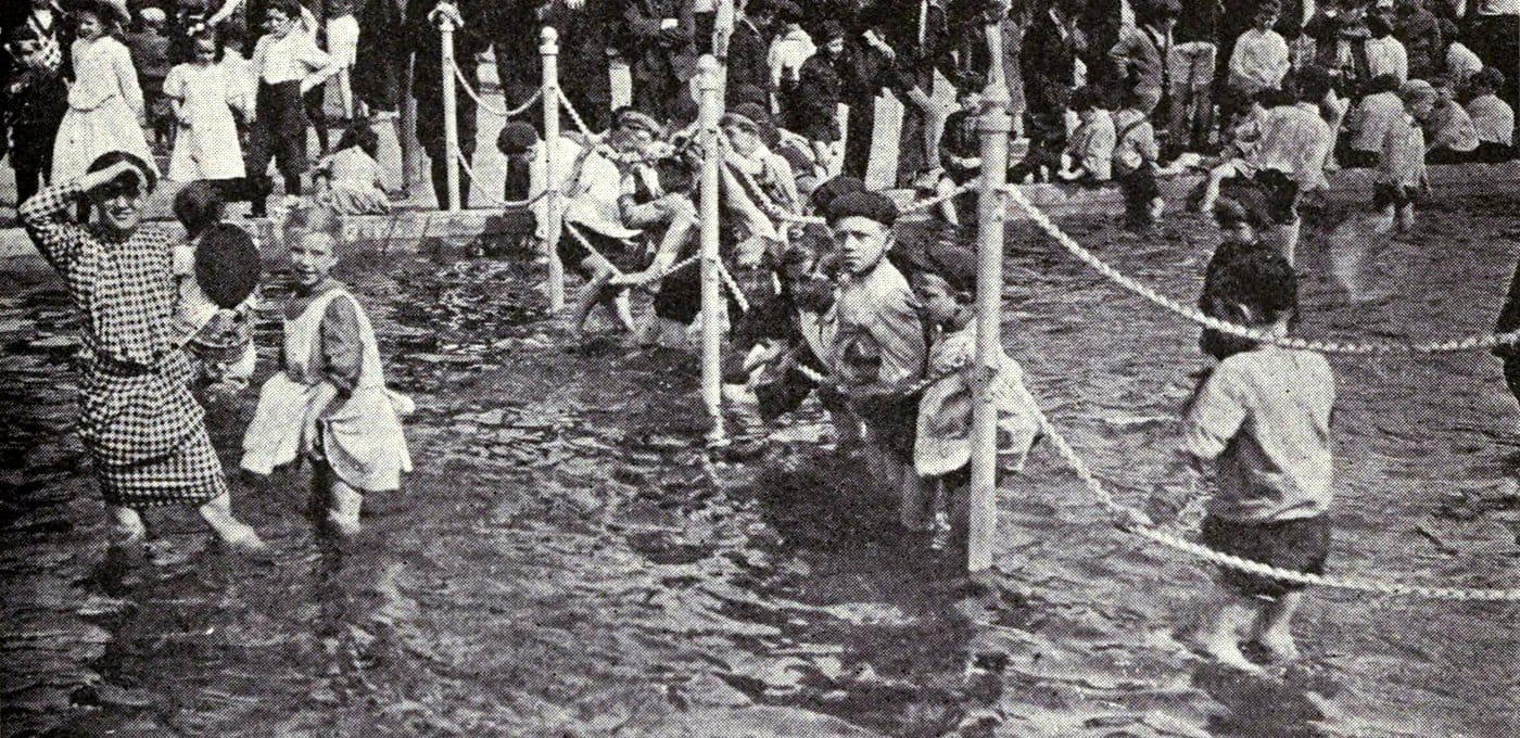 Vintage dangerous old playgrounds with a pool and chains c1920s