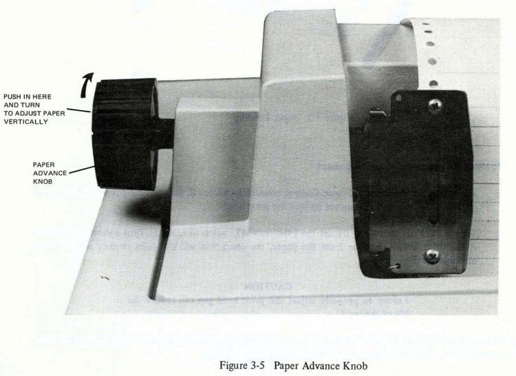 Vintage dot matrix printer paper advance knob close-up