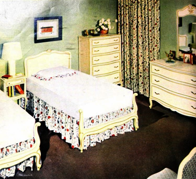 Vintage early 50s bedroom decor with two single twin beds separated