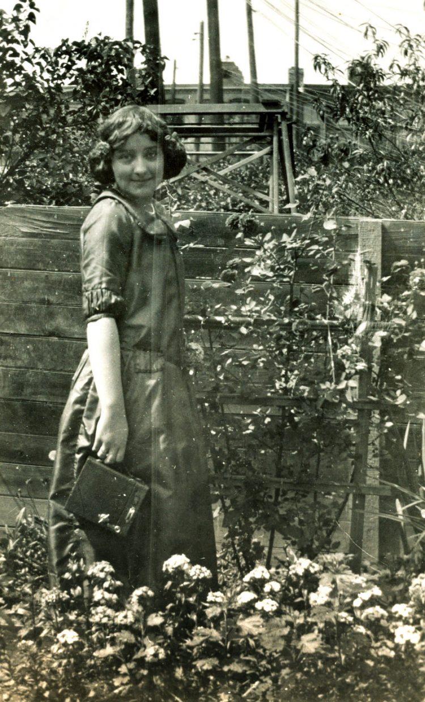 Vintage girl with an old Kodak Brownie camera
