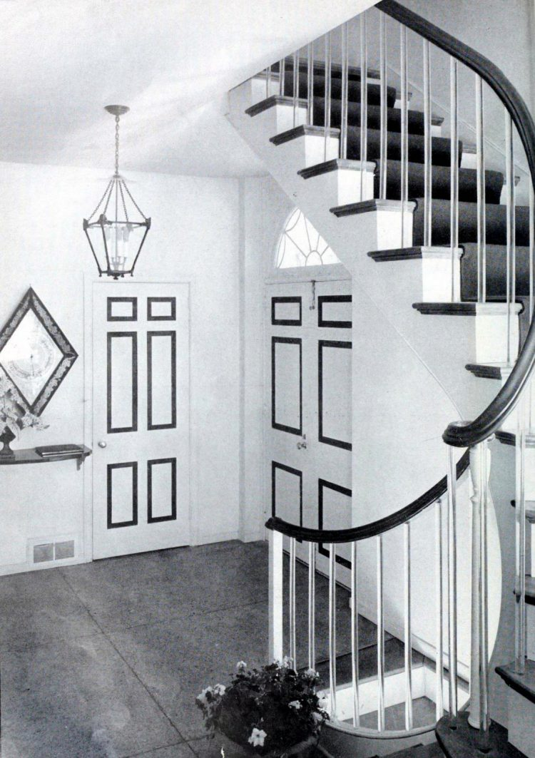 Vintage home entrance with curved staircase railing