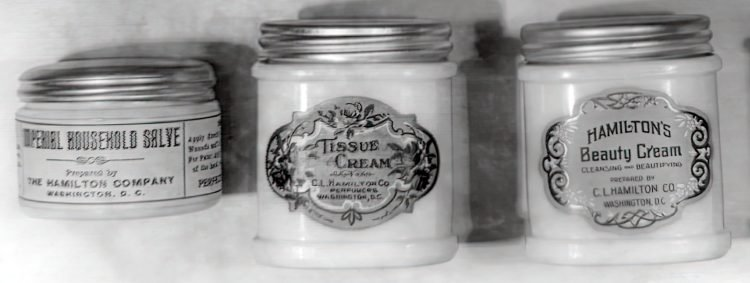 Vintage jars of beauty creams and salves