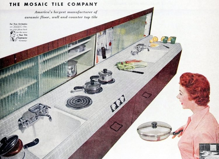 Vintage kitchen with tile countertops and sliding glass doors on cubbies