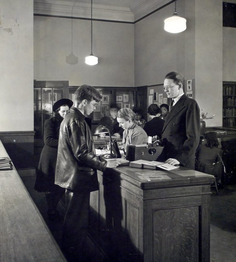 Vintage photo - Checking out books at an old library (2)