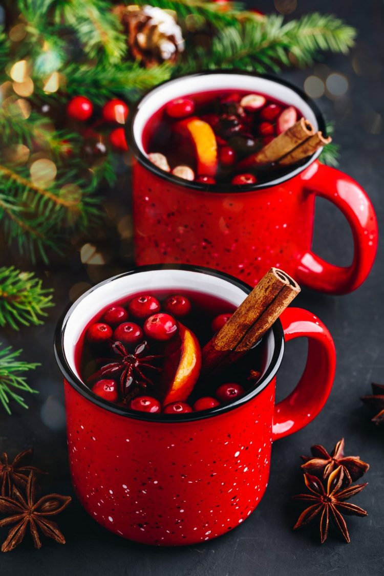 Traditional Christmas Mulled Wine drink with cranberries, orange
