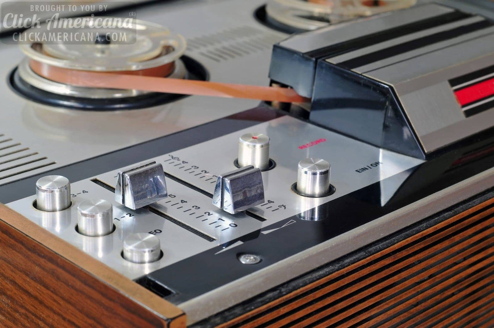 Close up photo of old reel to reel tape player