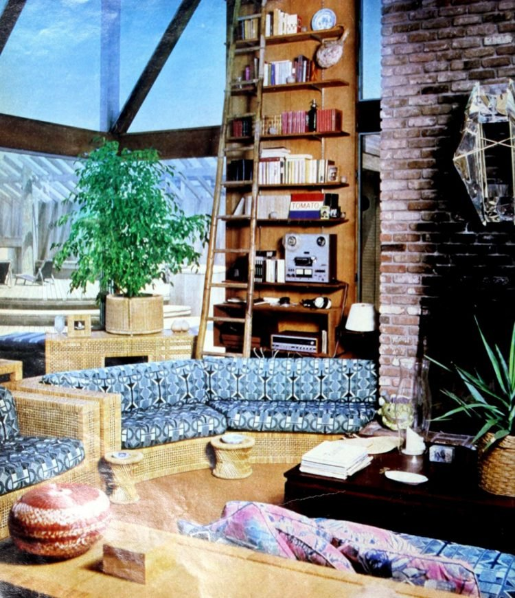 Vintage seventies room edged with wicker sofas with blue cushions