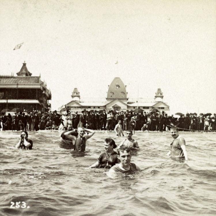 Vintage snapshot of people playing in the ocean