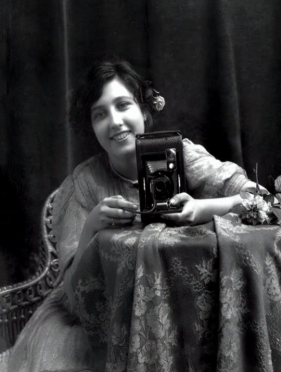 Vintage woman taking a selfie in a mirror - 1900s at ClickAmericana com