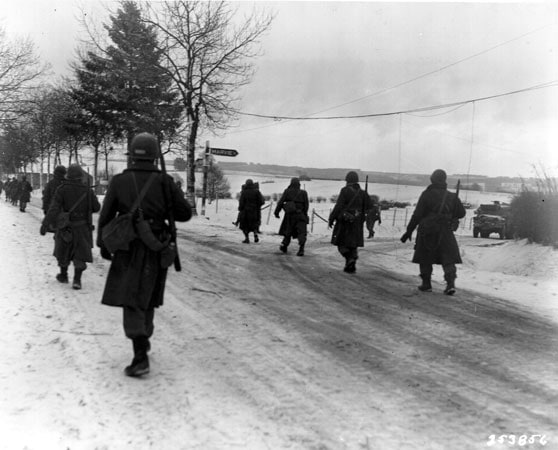 Walking on snowy cold roads - 1945 Battle of the Bulge, from US DOD