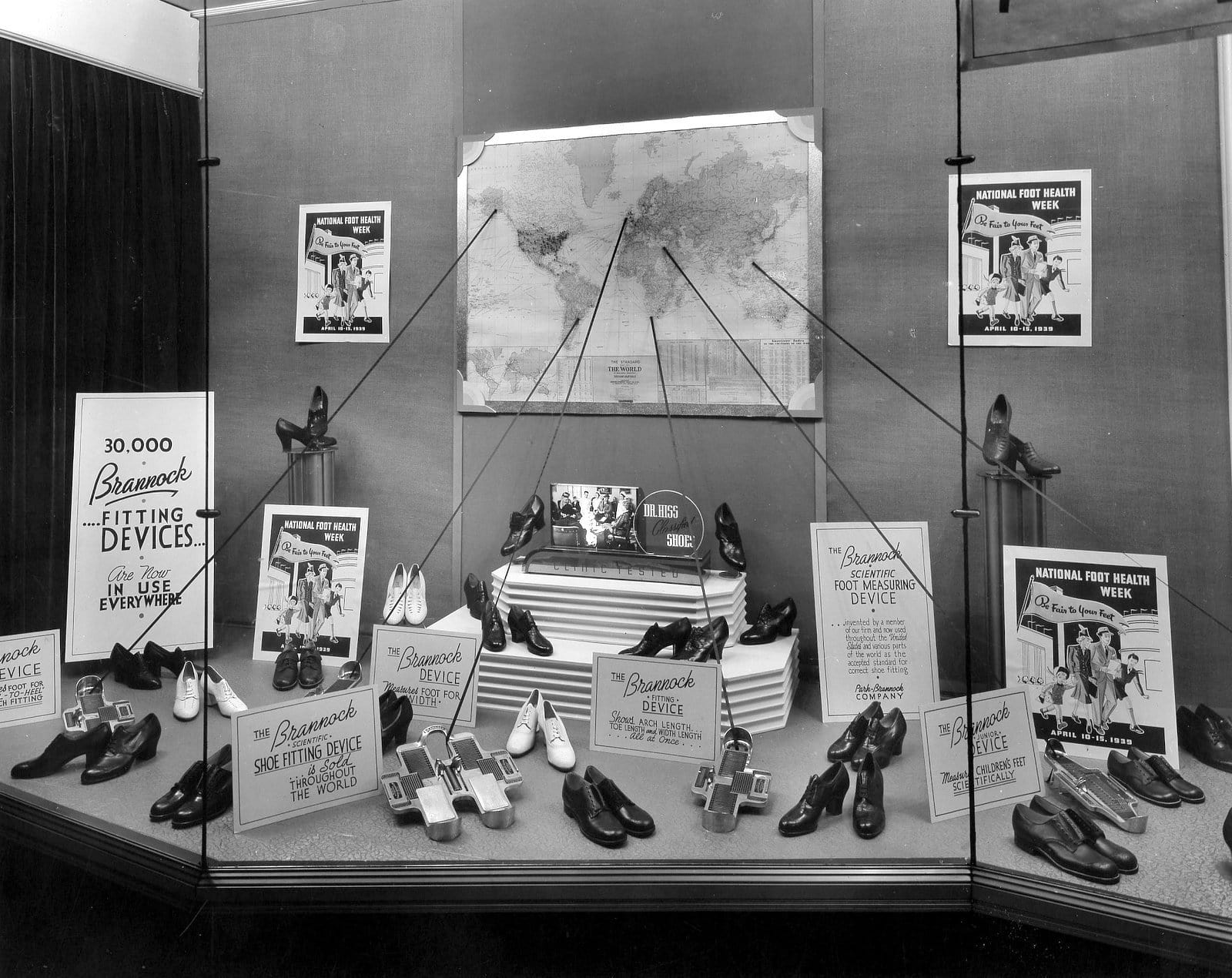 Window display of 1930s-1940s shoe store with Brannock Device fittings