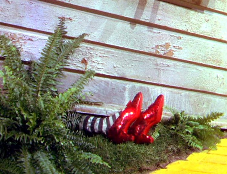 Wizard of Oz movie - Dead Wicked Witch of the East with ruby slippers