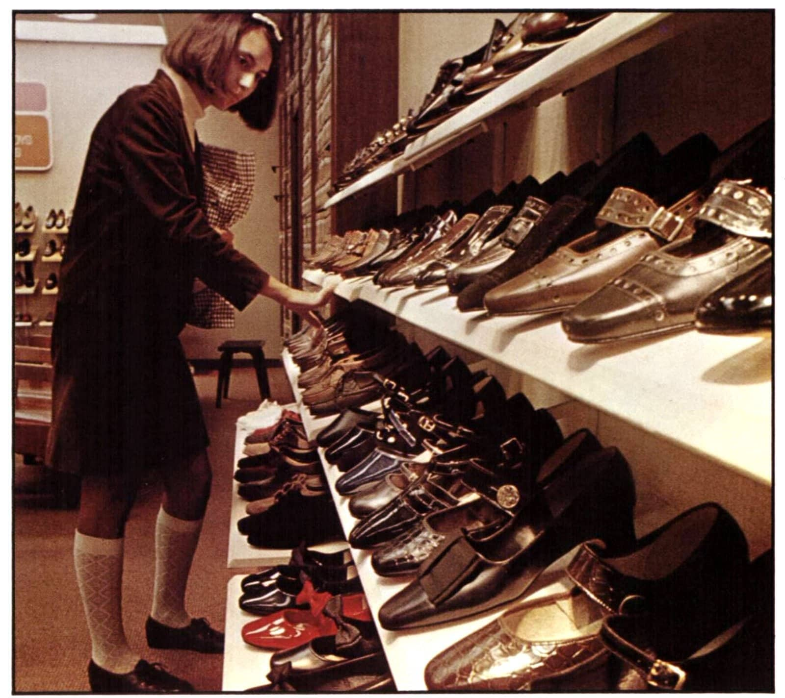 Woman buying shoes in 1968