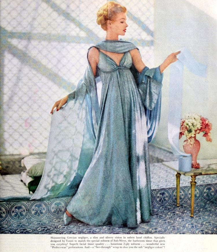 Woman in Grecian-style dress with a roll of toilet paper - 1959