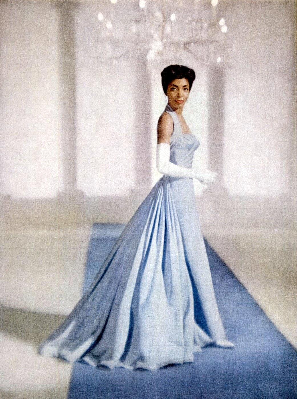 Woman in fancy blue retro evening dresss from Ebony Dec 1959