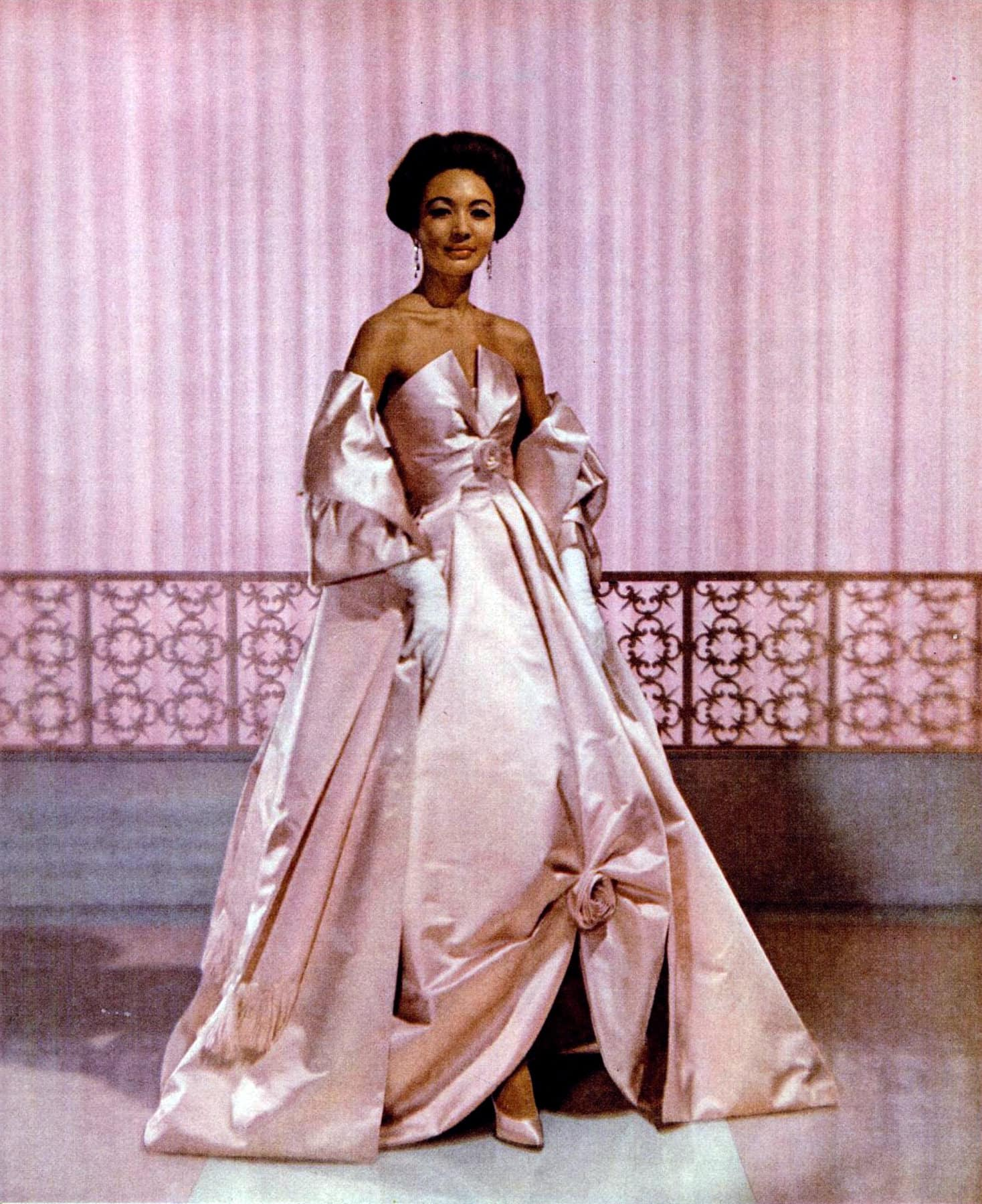 Woman in pink silk evening dress