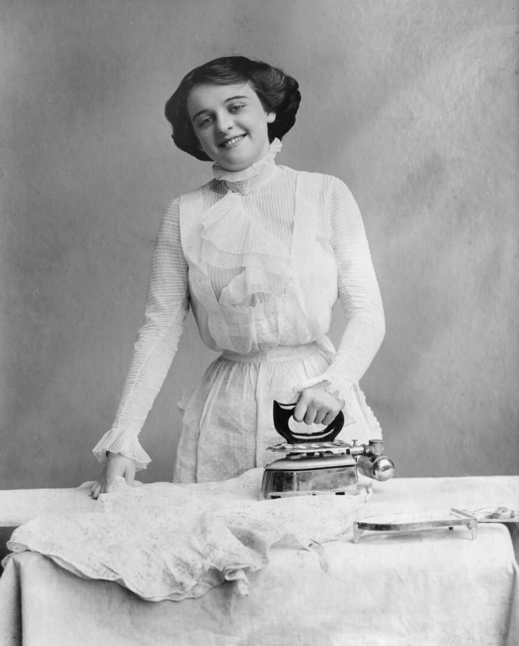 Woman ironing clothes c1914