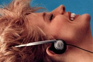 Woman listening to vintage Walkman stereo headphones