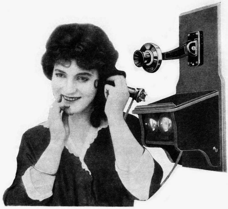 Woman on antique telephone