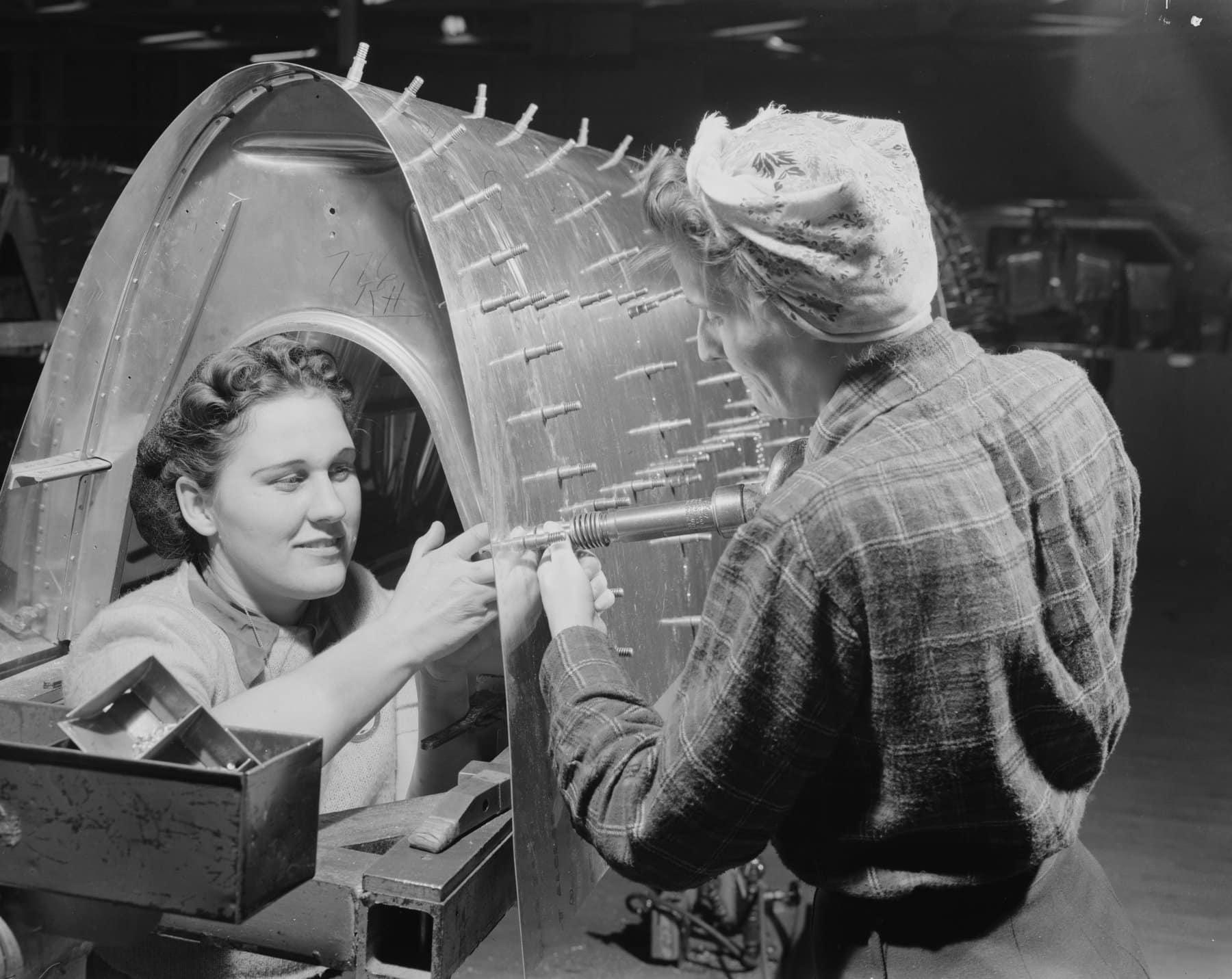 Woman riveting team working on a B-17F