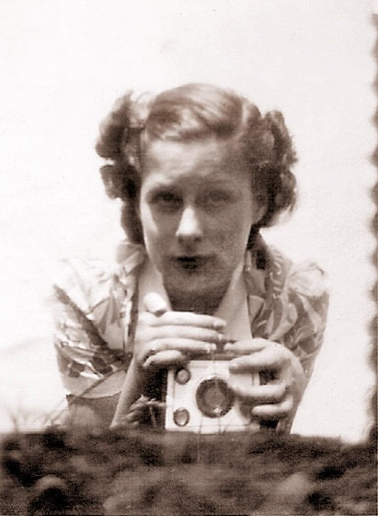 Woman taking a mirror selfie (1938) at ClickAmericana com