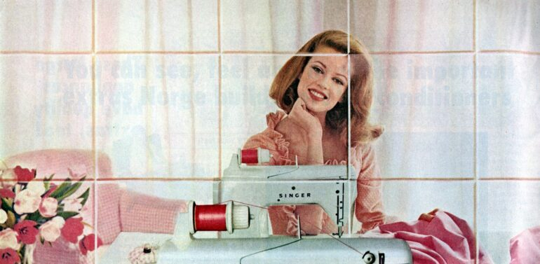 Woman with vintage Singer sewing machine from the sixties