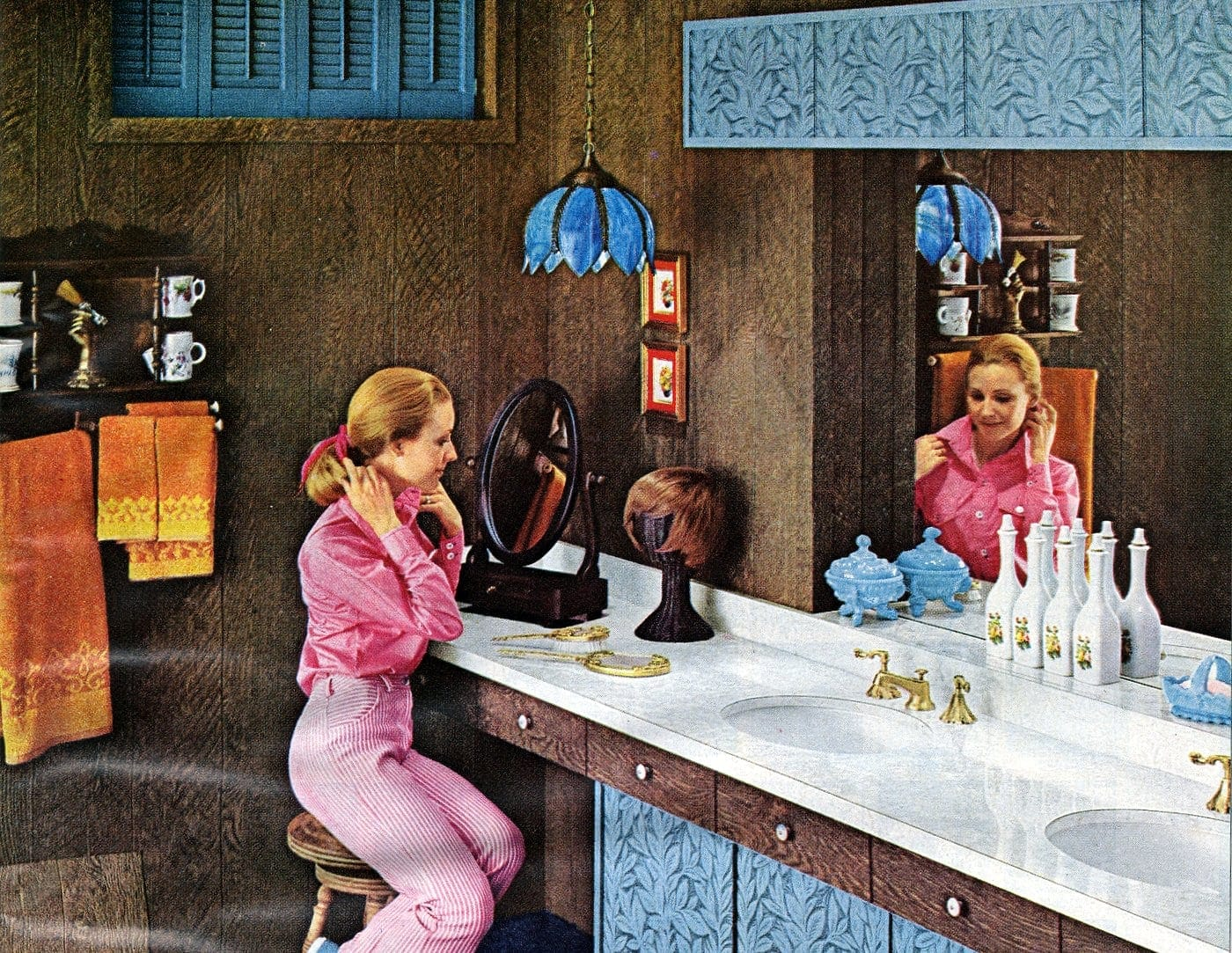 Wood paneled bathroom with blue laminate accents from 1970s