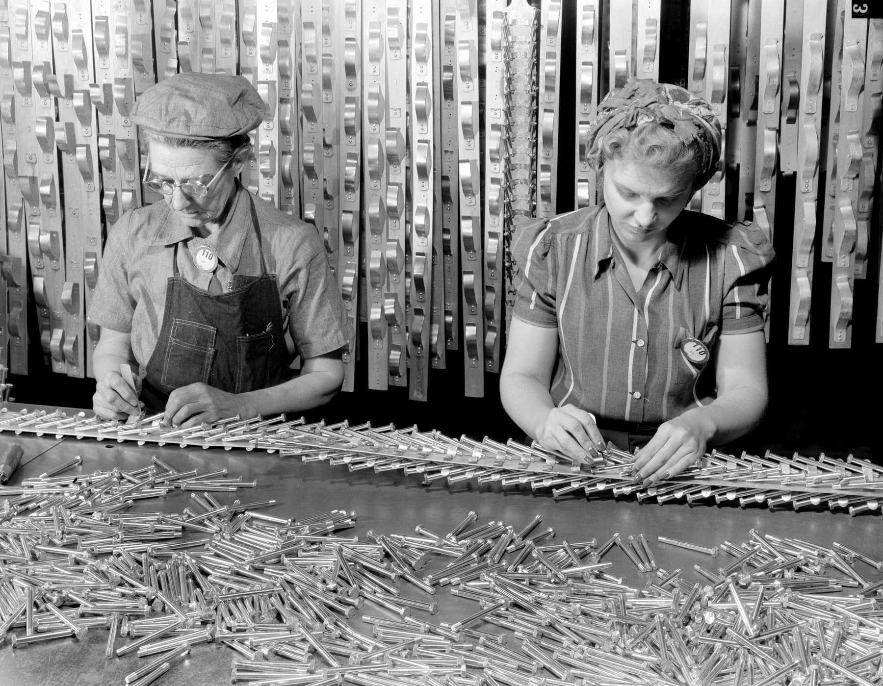 Workers with machine screws for WWII Flying Fortress bombers