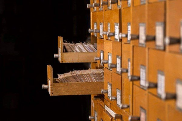 Old library reference catalogue with opened card drawer