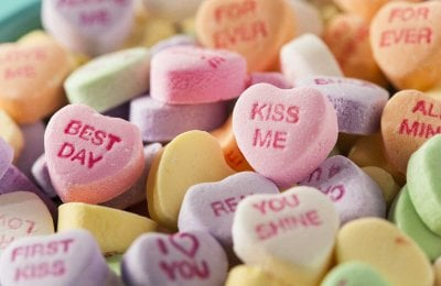 Where did those candy hearts with words on them come from?