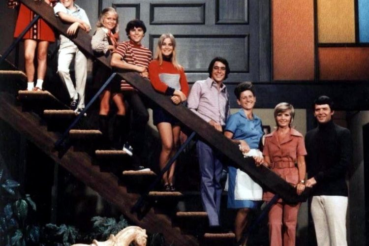 The Brady family on the stairs