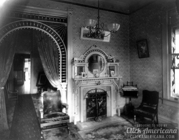 c1899-Interior view of room showing chandelier, decorative arch, fireplace, and furniture