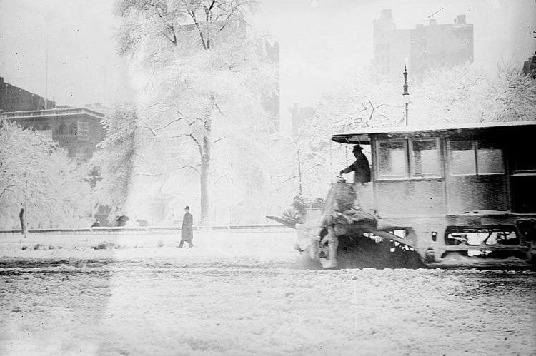 An old-time open-front snow plow in NYC (c1910)