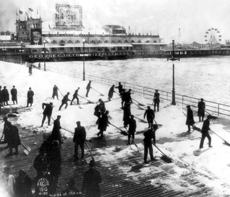 Clearing snow off the boardwalk in Atlantic City (1915)