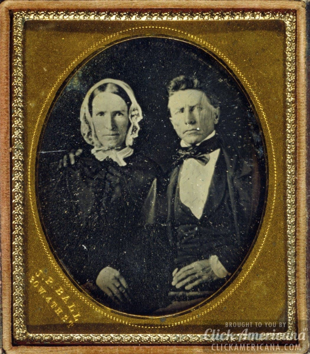 Antique photo of a stern-looking couple -- likely a husband and wife.