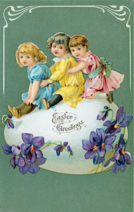 Three children on an egg vintage Easter card (1900s)