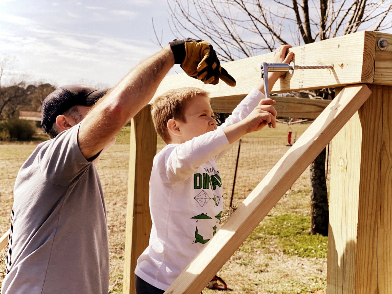 Father and son building a fort treehouse