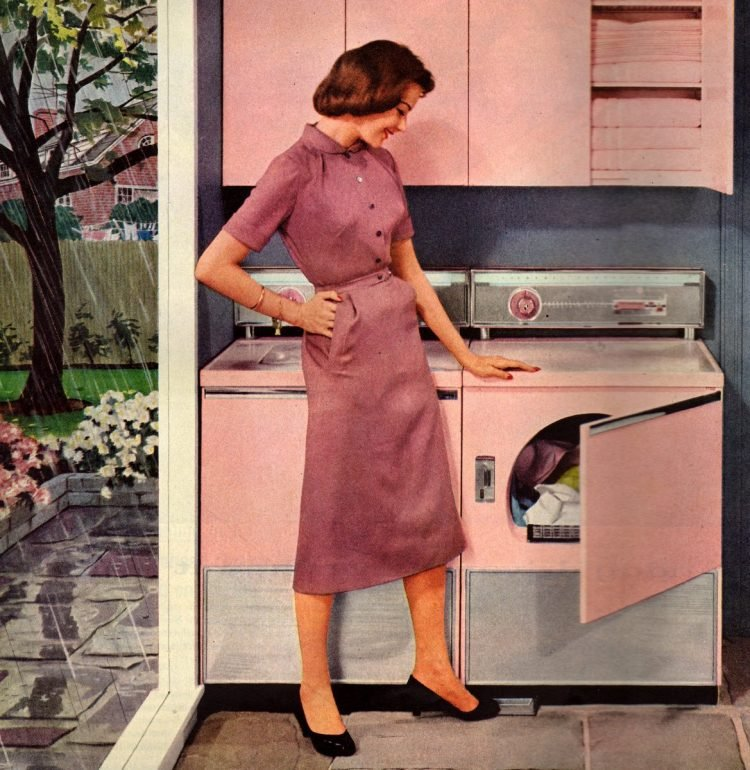 1950s housewife with her pink washer and dryer