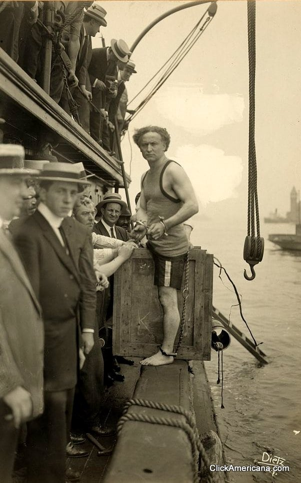 Houdini escapes from a box sunk in the East River (1912)