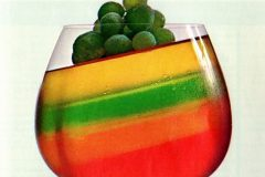 Multi-Stripe Delight Jell-O with frosted grapes (1960s)
