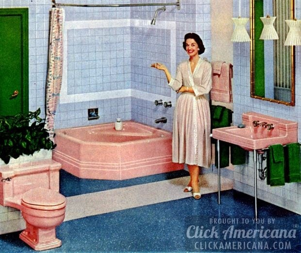 A rosy corner bathtub with matching sink and commode