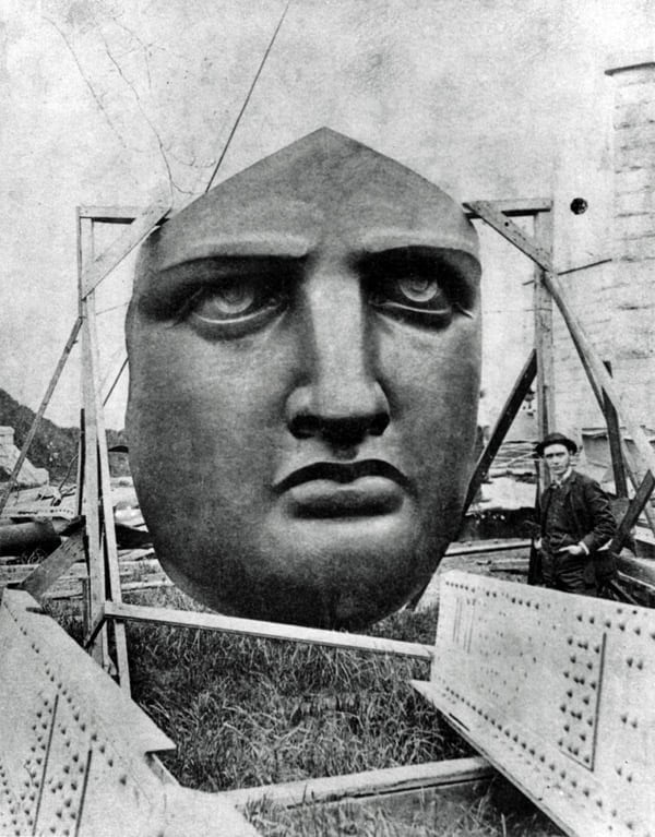 Lady Liberty's face is seen here on Liberty Island, waiting to be installed