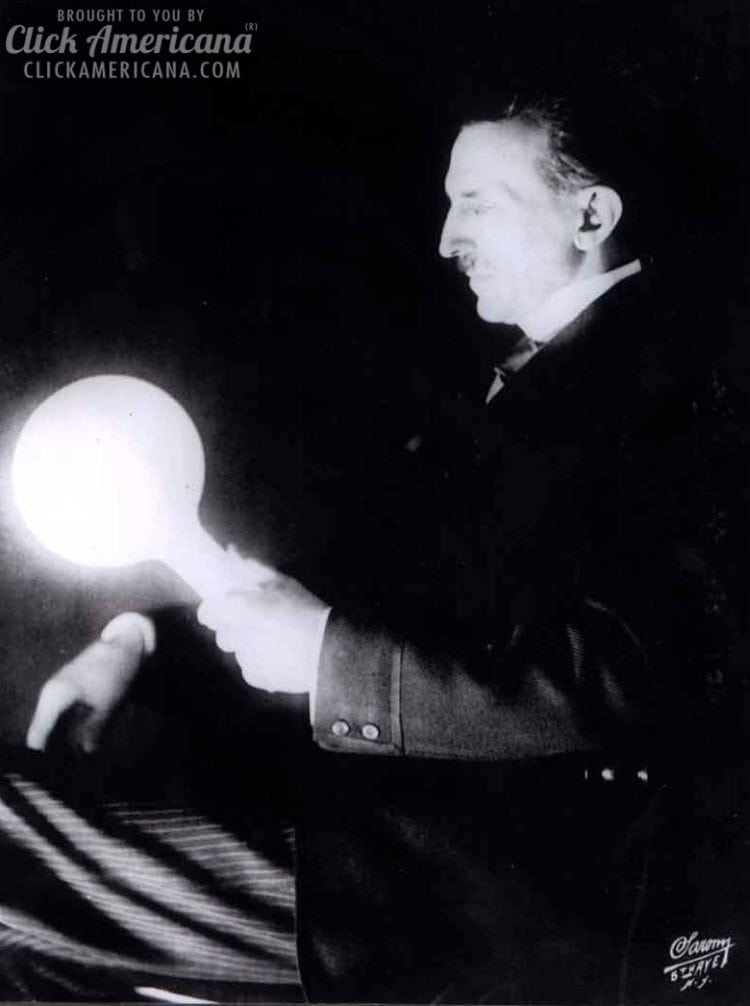 Nikola Tesla with a lightbulb in his hand - Nikola Tesla's plan to give free electricity to everyone (1896)