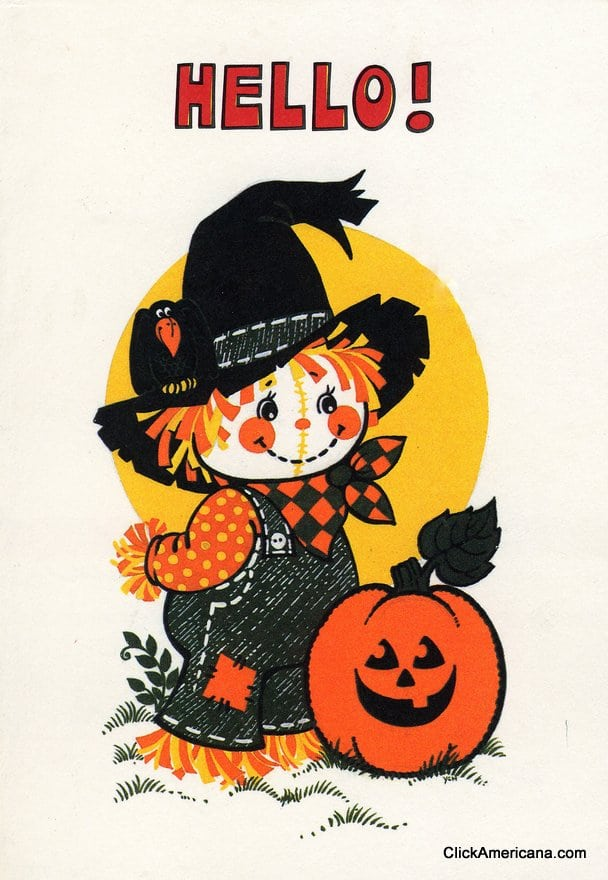 Halloween scarecrow and pumpkin