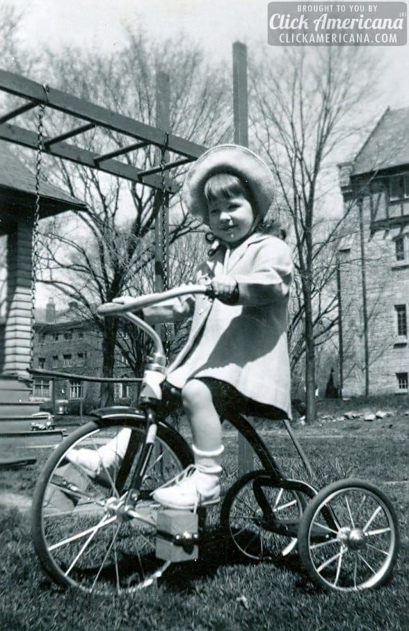 vintage-tricycle-girl-outside-blocks